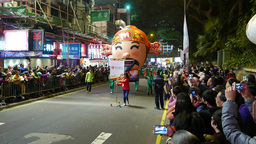 Big Asian Head Balloon, Festival, Procession On Night Street stock footage
