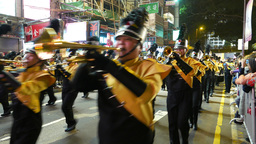 Orchestra marching on night street during parade, festival in HongKong Footage