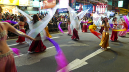 Belly dance school performance on night street during festival procession Footage