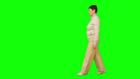 Woman Goes From Right To Left. Green Screen stock footage