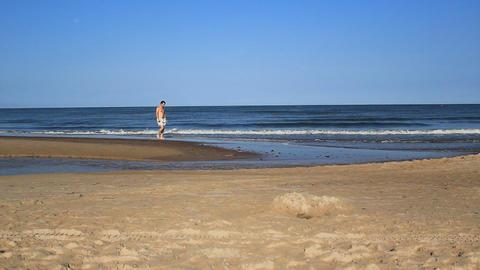 Man Running Walking Along The Coast Footage