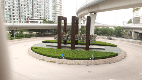 Massive stone hang in air, art sculpture in middle of roundabout, parallax shot Footage