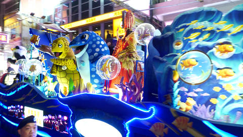 Funny Turtle And Shark Costumes At Night Festival Ceremony stock footage