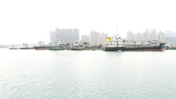 Many bunkering tankers anchered, against Tsing Yi island urban landscape Footage