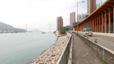 Move forward at sidewalk of embankment road, perspective view, harbour Live Action