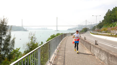 People running and biking on seafront road, sports lifestyle Footage