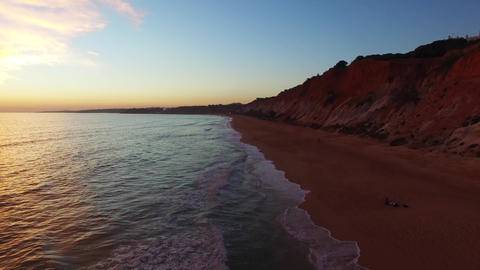 Portugal Algarve sunset oceanside cliffs beach aerial Footage