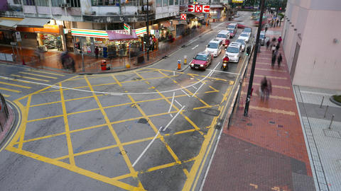 T-junction in dusk, cars stop and rush on green light, time lapse Footage