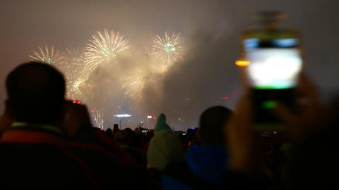 Crowd watching firework, black silhouettes, heads, hands with smartphone Footage