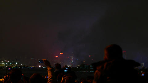 Little boy watching fireworks, sitting on shoulders of his father, blurred Footage