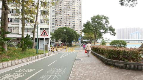 Walking on Tuen Mun river quay, to Yau Oi Bridge. Park exit to house apartments Footage