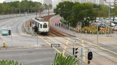 Comeng Light Rail Vehicle quickly drive away on curved rails line, overhead view Footage
