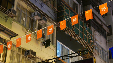 Small flags garland, chinese decoration against night sky and building Footage