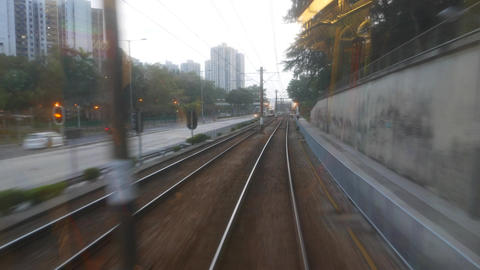 Back view from moving tram, clouded window glass, evening Footage