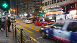 Car traffic pass pedestrian crossing on green light, night street Footage