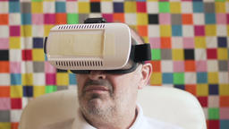 an elderly man with glasses of virtual reality,vr box Footage