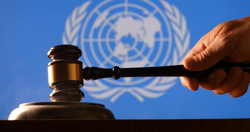 Judge Calling Order With Hammer Gavel In United Nations Court Flag Background stock footage