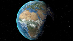 Night to day - rotating Earth. Zoom in on Algeria outlined Animation