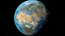 Night to day - rotating Earth. Zoom in on Belgium outlined Animation