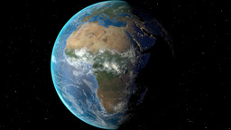 Night to day - rotating Earth. Zoom in on Cote Divoire outlined Animation
