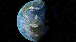 Night to day - rotating Earth. Zoom in on Guatemala outlined Animation