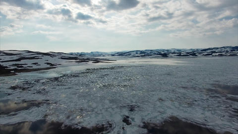 Frozen lake melting in Norway, aerial view Footage