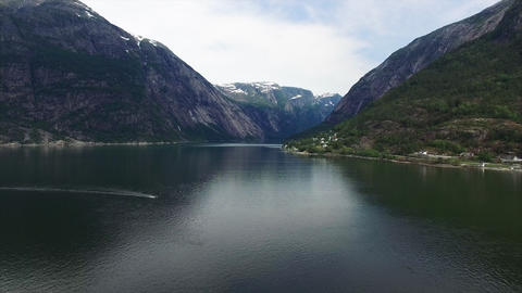 Small boat passing through Hardanger fjord in Norway Footage