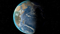 Night to day - rotating Earth. Zoom in on Malawi outlined Animation