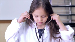 Child doctor puts on stethoscope Footage