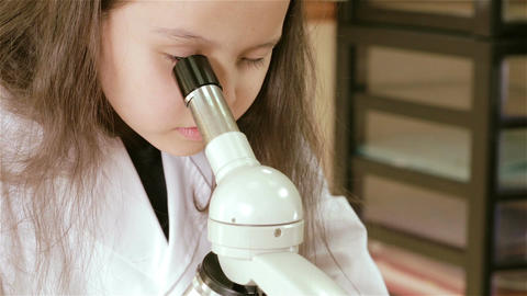 Child scientist looking into microscope closeup 2 Footage