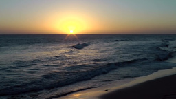 Spain The Canary Islands Gran Canary 031 Maspalomas sunset over water Footage