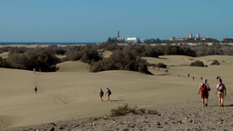 Spain The Canary Islands Gran Canary 012 many people walk in dunes Footage
