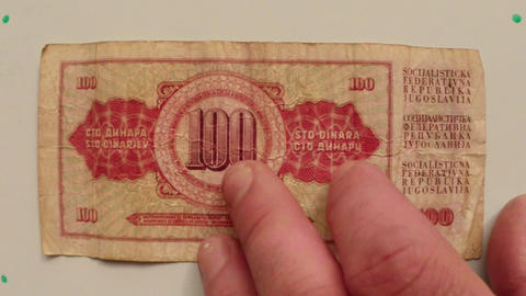 paper money 100 dinars National Bank of Yugoslavia in 1986 on a white table flip Footage