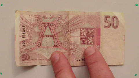 paper money 50 CZK Czech National Bank 1993 on a white table flipped a hand clos Footage
