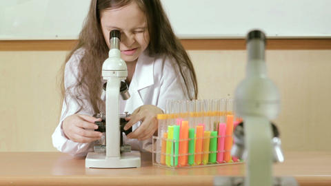 Young scientist looking through microscope Footage