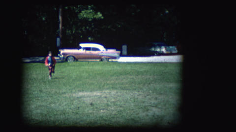 Vintage 8mm footage of a girl in a park Footage