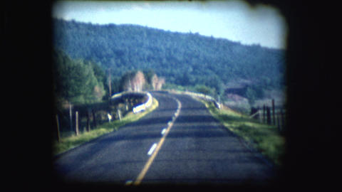 Vintage 8mm footage of a road Footage