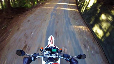 Helmet view. Bike is traveling the old road Footage