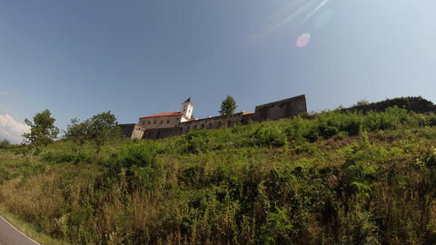 Mukachevo castle Palanok under the clear blue sky on a summer day medieval fortr Footage