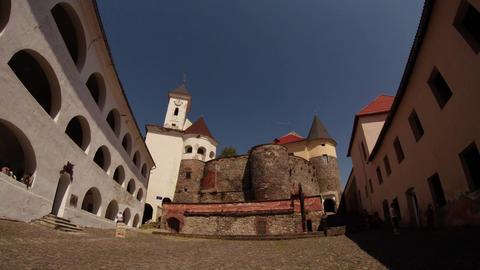 Average yard of Mukachevo castle Palanok under the clear blue sky on a summer da Footage