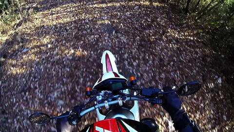 Helmet view. Rider is traveling the dirt Footage