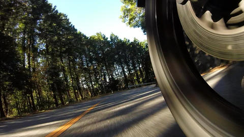 Rear wheel view. Rider is traveling downhill Footage