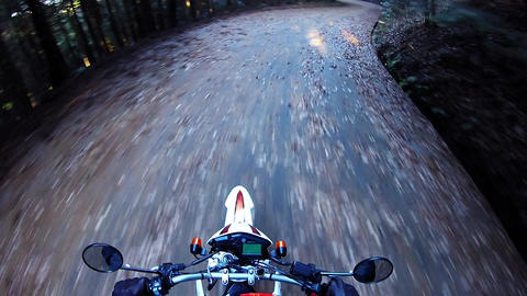 Helmet view. Rider is running on a forest road Footage