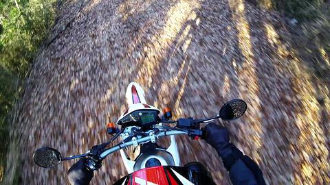 Helmet view. Rider is traveling on dirt Footage