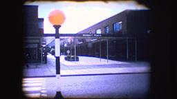 Vintage 8mm footage of a british road crossing Footage