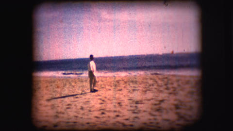 Vintage 8mm footage of a man on a California beach Footage