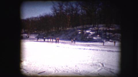 Vintage 8mm Footage Of People Skating On A Pond stock footage