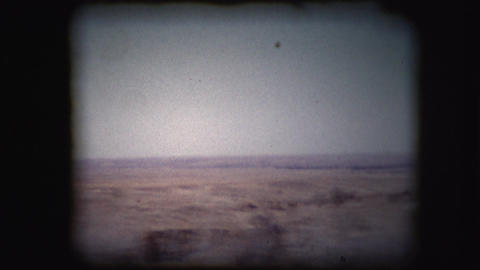 Vintage 8mm footage filmed through the window of a car Footage