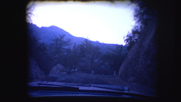 Vintage 8mm footage film through the window of a car Footage