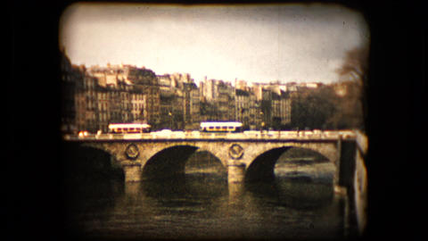 Historic footage of a bridge over the Seine river in Paris Footage